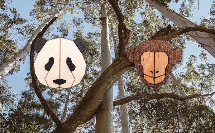 Die Affen und Panda Holzbroschen in den Tropen