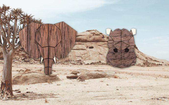 Die Elefanten und Flusspferd Holzbroschen in der Landschaft Afrikas